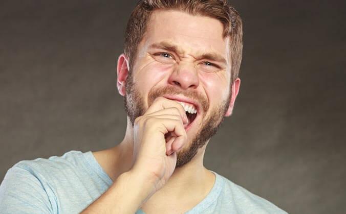 Почему может болеть зуб, если нерв удален давно?