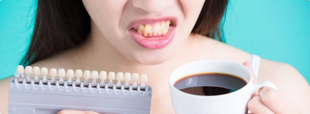 Почему чернеют зубы – общие причины